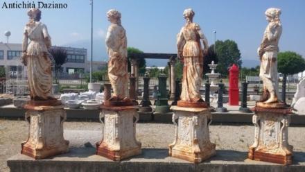 Statue quattro stagioni in ghisa su piedistallo
