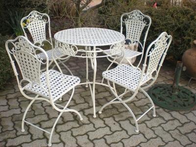 Set tavolo e quattro sedie in ferro